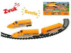 Vlak s vagónmi a dráhou